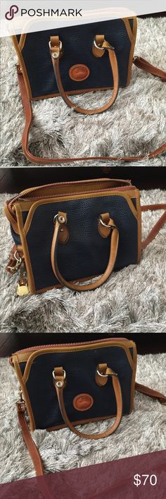 Dooney & Bourke Purse Dooney & Bourke Purse. Good condition. Navy Blue and Tan. Dooney & Bourke Bags