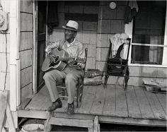 """Mance Lipscomb (1895-1976) was born in Texas. His father was African-American and had been enslaved.  His mother was mixed-race: African-American and Choctaw.  He took the name Mance, short for """"emancipation.""""  Lipscomb spent his life as a Sharecropper.   It wasn't until he was """"discovered"""" and recorded by two white musicologists that he was heralded as a musician.  He became an important figure in the folk music revival of the 1960's influencing Dylan and Janis Joplin among others."""