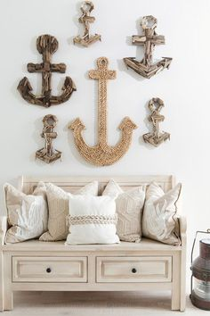 Anchors. Coastal Foyer with anchors on wall. Anchors of different sizes and…
