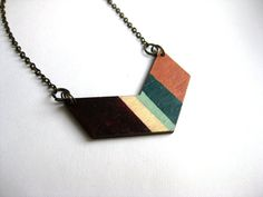 Geometric wooden necklace in eggplant purple, mint, blue and pink