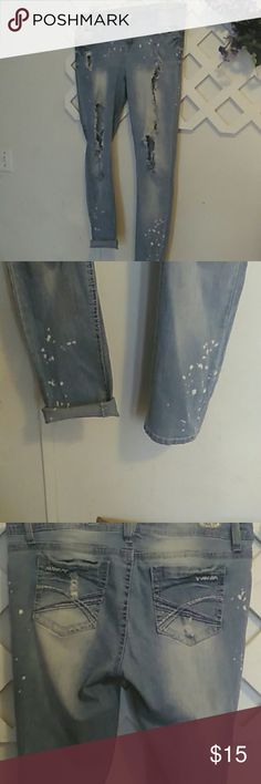 Distressed jeans Light colored with white specks on bottom legs.Very distressed.can be rolled up or left down.Skinny jeans..Size 17 .Stretchy .Can fit a 15 to 18. Wallflower Jeans Skinny