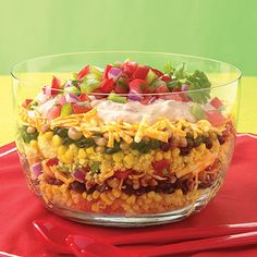 This beautiful Southwest salad recipe is layered with cornbread and Mexican ingredients. It's perfect for summer meals when serving a large crowd.