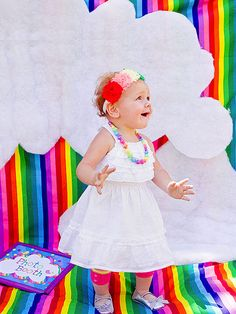 Use this rainbow-themed first #birthday party guide to plan a colorful event for your little one! http://www.parents.com/fun/birthdays/first/flying-over-the-rainbow-party/?socsrc=pmmpin130703bpRainbow