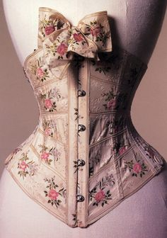 this has got to be the prettiest ribbon corset I have ever seen. It's constructed from silk floral ribbon, dated to 1900-5 and it lives in the Bath Fashion Museum.