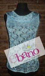 Remera tejida a dos agujas en hilo de seda de color celeste matizado. Consultar colores disponibles.   (Two needles knit shirt in nuance light blue silk thread. Check available colors.)