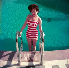 Austrian actress Mara Lane posing by the pool at the Sands Hotel, Las Vegas, in a red and white striped bathing costume. (Photo by Slim Aarons/Getty Images) Slim Aarons Prints, Robert Klein, Star Of The Day, Sands Hotel, Bathing Costumes, Vintage Classics, High Society, Red And White Stripes, Unique Image