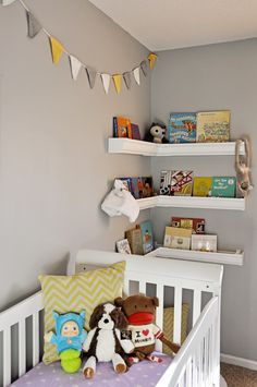 nursery shelves - top shelf for yearly figurine. The rest for books
