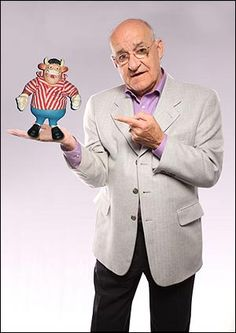 "Watch Peter Kay's brilliant impersonation of Jim Bowen from Bullseye. http://www.youtube.com/watch?v=N7B2z9KG9w8 Jim Bowen. Possibly the most talentless man to ever land a job on British TV screens. Best known as host of gameshow ""Bullseye"" Bowen's jokes were absolutely dreadful and he possessed zero charisma. Most recently has lost his job as a radio show host after referring to black people as the N word. Jim Bowen - he's absolutely shit."