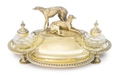 A Victorian Silver-gilt Inkstand, Robert Garrard II, London, of quatrefoil form on four leafy supports, the raised central compartment with hinged cover surmounted by reclining and standing greyhounds. Vintage Dog, Vintage Pens, Greyhound Art, Desk Set, Quatrefoil, Writing Instruments, Wax Seals, Whippet, Cut Glass