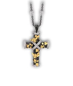 One of a limited edition of 25 Crosses, a variation on the theme of Theo Fennell's classic design.The finely detailed Yellow Gold Ivy climbs over the 3.07ct Black & 0.98ct White Diamond body - like an overgrown Secret Garden.