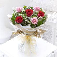 Six Stolen Kisses Red and Pink. This chic, classic half dozen showcases the very finest large headed red and pink roses beautifully. The roses and gypsophila complement each other perfectly, and the elegant wrap and ribbon add a sophisticated finishing touch.