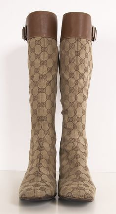 GUCCI ・ Gucci Brown Logo Monogrammed Knee High Boots with Brown Leather/buckle top. These square toe boots are iconic Gucci with a Vintage Flare and the comfort of a kitten heel.