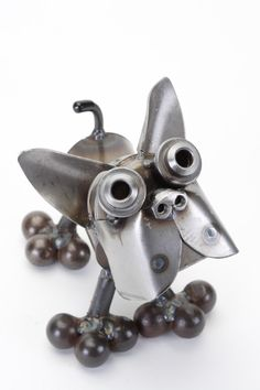 Boston Terrier Statue. This cute little dog statue looks up at you with great big eyes and wants to be held. Made from metal each piece will vary slightly as they are handmade.