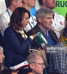 Michael and Carole Middleton at Rugby World Cup, Oct. 3, 2015. Carole is enjoying a bag of crisps.