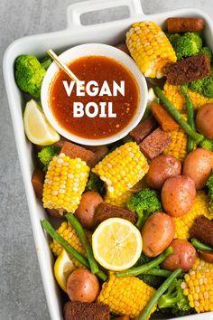 CajunInspired Vegan Boil No crab or seafood here just veggies like corn on the cob green beans and potatoes alongside vegan sausage and an incredible cajun butter sauce Vegan Foods, Vegan Dishes, Vegan Vegetarian, Vegetarian Recipes, Healthy Recipes, Easy Vegan Food, Eating Vegan, Vegan Lunches, Vegan Meals