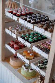 Love the simple white display boxes. Allows for the cupcakes and baked goods to really show without cluttering.