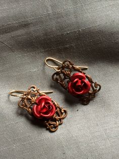 Red Roses on Brass Trellis Filigree. http://www.thephunkyphoenix.com