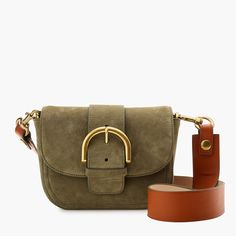 Meet our new crossbody bag in luscious Italian suede: with a subtle equestrian vibe and a rich contrast leather strap, it's as original as you are. Bonus: it includes an interior pocket and card slot to keep you organized. 5 1/4H x 7 1/2W x 2 1/2D. Drop: 23 max - adjustable. Adjustable strap. Leather. Italian suede. Import. Select stores.