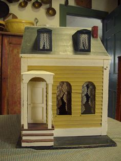 Google Image Result for http://www.barbarapeterantiques.net/images/dollhouse2.jpg