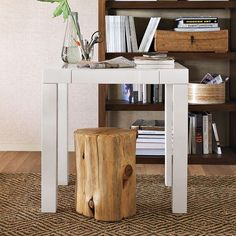 A natural tree stump side table, like this one from West Elm, adds the right rustic element to modern furniture.