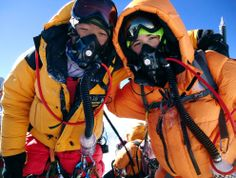 13-year-old Jordan Romero, right, poses for photos with a Sherpa guide on the summit of Mount Everest on May 22, 2010. Jordan became the youngest climber to reach the top of Mount Everest after climbing it from the Chinese side accompanied by a team that included his father, his stepmother and three Sherpa guides. (Team Romero via Associated Press) #