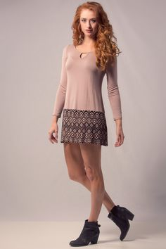 A soft tunic dress with long sleeves and print on the bottom. Pair with some chunky boots.