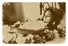 antique post mortem photography,She looks like a young Liz Taylor,how beautiful,and how very sad.