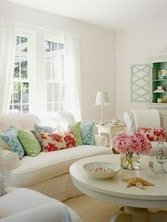 I like the idea of a fluffy white bed with accent pieces