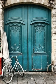 Teal door, white brick
