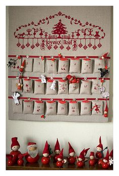 Advent Calendar made from burlap sacks and red ribbon. Way smarter than trying to stuff items in those tiny boxes! Christmas Calendar, Countdown Calendar, Christmas Countdown, Calendar Ideas, Christmas Sewing, Christmas Cross, Christmas Holidays, Christmas Decorations, Advent