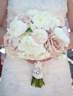 Pale pink and white: roses, ranunculus, peonies, hydrangeas. (replace bling with pearls)