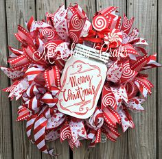 Merry Christmas Wreath - Christmas Candy Wreath - Christmas Mason Jar Wreath - Christmas Door Hanger - Red and White Christmas Wreath by MsSassyCrafts on Etsy https://www.etsy.com/listing/491284577/merry-christmas-wreath-christmas-candy