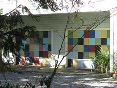 Garage door with a checkered design. Garage Door Paint, Garage Door Colors, Garage Door Repair, Garage Door Opener, Street Wall Art, Street Art Graffiti, Unique Garage Doors, Door Murals, Big Project