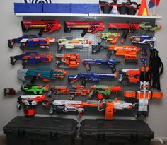 Nerf gun wall display. This was made from slat wall board purchased at  Menards.