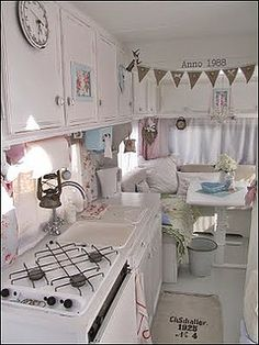 What a great way to decorate a camper!  shabby chic caravan by Faerie Nuff, via Flickr