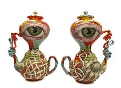 "Michael Lucero (1953- ), American / ""Pair of Double Eye Teapots with Buttons"" ....  teapot with oversized eyeball decoration, 2009, clay with glazes, USA"