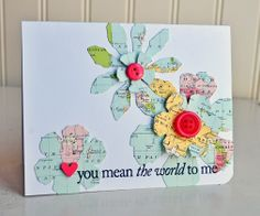 love the idea of the maps as the paper for the flowers, along with that sentiment!