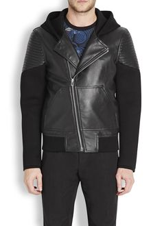 Givenchy black leather biker jacket Neoprene hood, sleeves and back, press stud fastening lapels, ribbed arm panels, zipped cuffs, front patch pockets, ribbed hem, internal slip pockets, fully lined Asymmetric zip fastening through front Fabric1: 100% leather (lamb); fabric2: 100% viscose; lining: 100% cupro Specialist clean Length shoulder to hem: 25 inches/ 63cm Midweight Semi-fitted style RRP: £1,715.00 (harvey nichols)  New Season (Winter/2014)