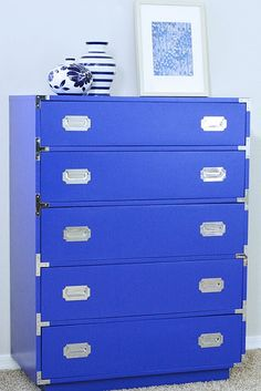 """""""Natty by Design"""" blue campaign dresser with what looks to be silver fixtures. Blog post includes before and after photos."""
