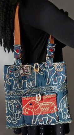 """Enjoy sporting this eye-catching, OOAK, all-occasion, handmade, sizeable, fabric shoulder bag (with matching accessories). This unique item is created using a heavyweight upholstery fabric and with faux suede shoulder straps (28 inches in length). The fabric is an elegant """"elephant-walk"""" design. This artistically designed and functional shoulder bag: •Measures 13 W x 11.25L •Includes 4 convenient interior pockets (for cellphone, writing tool and other choice items) and an additional…"""