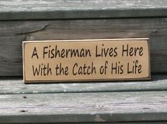 A Fisherman Lives Here with the Catch of His Life- Primitive Country Painted Wall Sign. $9.00, via Etsy.  Great gift for Craig's parents!