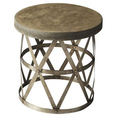 Add eye-catching appeal to your home library or living room with this industrial-inspired end table, showcasing an openwork metal base with rivet details.