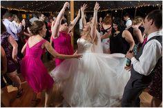 Bride twirling at wedding reception. Delfosse Vineyards & Winery Virginia Wedding. Laura's Focus Photography.