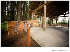 """""""I Dos"""" handmade wood and metal sign pointing to this wedding ceremony at Kitsap Memorial State Park // tylerandhannah.com #rusticwedding #weddingsign"""