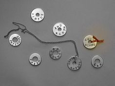 Under My Umbrella: Washer Necklaces.  I have the stamps and the washers and the hammer...just need to do this one!!!