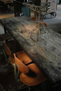 barn wood tables and old school chairs HMMMM Unique Furniture, Repurposed Furniture, Old School House, Basement Inspiration, Old Farm Houses, Restaurant Interior Design, Dark Interiors, Dining Room Lighting, Reclaimed Barn Wood