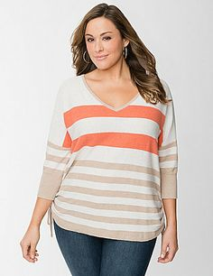 Soft, fine gauge sweater with drawstring ruching on the sides offers a  sassy, modern fit made for curves. This flattering top is a hit for the  season with an eye-catching mix of stripes for that fun pop of color.  V-neck and 3/4 sleeves with ribbed cuffs complete the look. lanebryant.com