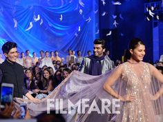 Ace designer Manish Malhotra's show yesterday at the Lakme Fashion Week was a summer bonanza with all things glitzy. Arjun Kapoor and Jacqueline Fernandez made the perfect showstoppers as they walked the ramp for the designer. Arjun looked suave as always oozing confidence and Jacqueline's ethereal beauty wowed the crowds. The duo took the ramp with the designer himself amidst all the applause. For all the pictures from the show visit www.filmfare.com by #Filmfare. Shared by #BollywoodScope