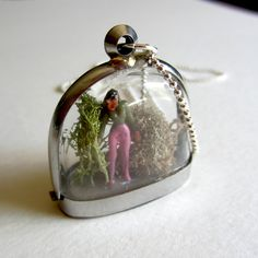 Miniature dome window terrarium locket with tiny person standing. Clear windows. Medium length ball chain on Etsy, $27.92