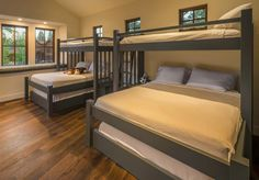 Twin Loft over King over Queen bunk bed that sleeps 5-10 - Custom Made and Set up for about $2400 as a Single and $4000 for Double Units. Parkcitybunkbeds.com